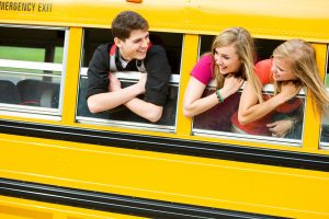 School Bus: Teens Leaning Out Bus Window